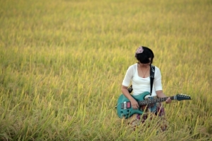 Blue Guitar in Field